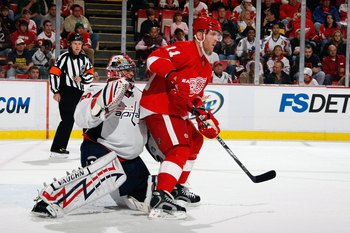DETROIT - OCTOBER 10:  Dan Cleary #11 of the Detroit Red Wings sets up in front of Jose Theodore #60 of the Washington Capitals during the game on October 10, 2009 at Joe Louis Arena in Detroit, Michigan. (Photo by Gregory Shamus/Getty Images)