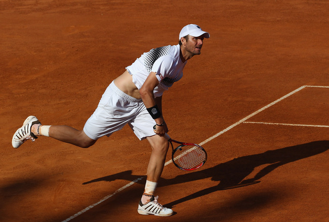 ROME, ITALY - MAY 09:  Mardy Fish of the USA serves during his first round match against Santiago Giraldo of Columbia during day two of the Internazoinali BNL D'Italia at the Foro Italico Tennis Centre on May 9, 2011 in Rome, Italy.  (Photo by Clive Bruns