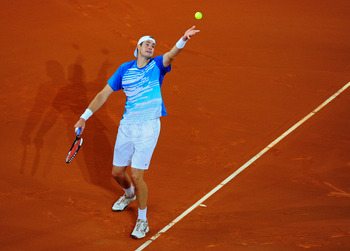 MADRID, SPAIN - MAY 13:  John Isner of the USA serves the ball to Rafael Nadal of Spain in his third round match during the Mutua Madrilena Madrid Open tennis tournament at the Caja Magica on May 13, 2010 in Madrid, Spain.  (Photo by Jasper Juinen/Getty I