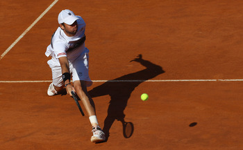 ROME, ITALY - MAY 09:  Mardy Fish of the USA plays a forehand volley during his first round match against Santiago Giraldo of Columbia during day two of the Internazoinali BNL D'Italia at the Foro Italico Tennis Centre on May 9, 2011 in Rome, Italy.  (Pho
