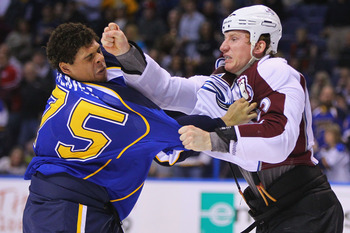 ST. LOUIS, MO - APRIL 5: Ryan Reaves #75 of the St. Louis Blues fights Cody McLeod #55 of the Colorado Avalanche at the Scottrade Center on April 5, 2011 in St. Louis, Missouri.  (Photo by Dilip Vishwanat/Getty Images)
