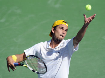 INDIAN WELLS, CA - MARCH 10:  Ryan Sweeting serves in his match against Marcel Granollers of Spain during the BNP Paribas Open at the Indian Wells Tennis Garden on March 10, 2011 in Indian Wells, California.  (Photo by Harry How/Getty Images)
