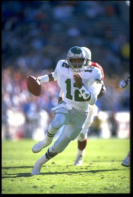 1990:  PHILADELPHIA EAGLES QUARTERBACK RANDALL CUNNINGHAM SCRAMBLES FOR EXTRA YARDAGE DURING THE EAGLES GAME VERSUS THE PHOENIX CARDINALS AT SUN DEVIL STADIUM IN TEMPE, ARIZONA.  MANDATORY CREDIT:  MIKE POWELL/ALLSPORT
