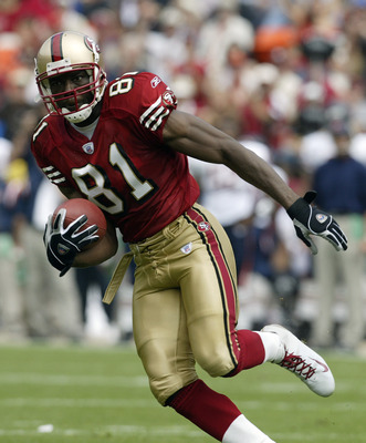SAN FRANCISCO - SEPTEMBER 7:  Wide receiver Terrell Owens #81 of the San Francisco 49ers moves the ball   during the game against the Chicago Bears on September 7, 2003 at Candelstick Park in San Francisco, California. The 49ers defeated the Bears 49-7. (