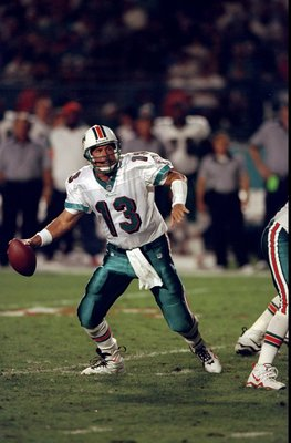 29 Nov 1998:  Quarterback Dan Marino #13 of the Miami Dolphins in action during the game against the New Orleans Saints at the MCI Center in Miami, Florida. The Dolphins defeated the Saints 30-10. Mandatory Credit: Vincent Laforet  /Allsport