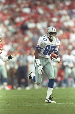 8 Dec 1996:  Wide receiver Michael Irvin of the Dallas Cowboys carries the football after making a catch during the Cowboys 10-6 win over the Arizona Cardinals at Sun Devil Stadium in Tempe, Arizona. Mandatory Credit: Otto Greule Jr.  /Allsport