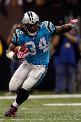 NEW ORLEANS - OCTOBER 03:  DeAngelo Williams #34 of the Carolina Panthers in action during the game against the New Orleans Saints at the Louisiana Superdome on October 3, 2010 in New Orleans, Louisiana.  (Photo by Chris Graythen/Getty Images)
