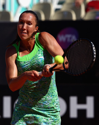 ROME, ITALY - MAY 13:  Jelena Jankovic of Serbia plays a backhand during her quarter final match against Caroline Wozniacki of Denmark during day six of the Internazoinali BNL D'Italia at the Foro Italico Tennis Centre  on May 13, 2011 in Rome, Italy.  (P