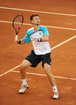 MADRID, SPAIN - MAY 06:  Robin Soderling of Sweden follows a high ball in his match against Roger Federer of Switzerland during day seven of the Mutua Madrilena Madrid Open Tennis on May 6, 2011 in Madrid, Spain. Federer won the match in straight sets.  (