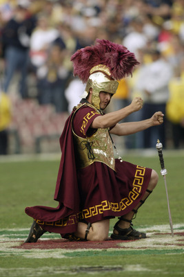 PASADENA, CA - JANUARY 1:  Tommy Trojan, mascot of the USC Trojans entertains the crowd during an intermission in the 2004 Rose Bowl game against the Michigan Wolverines on January 1, 2004 at the Rose Bowl in Pasadena, California. USC defeated Michigan 28