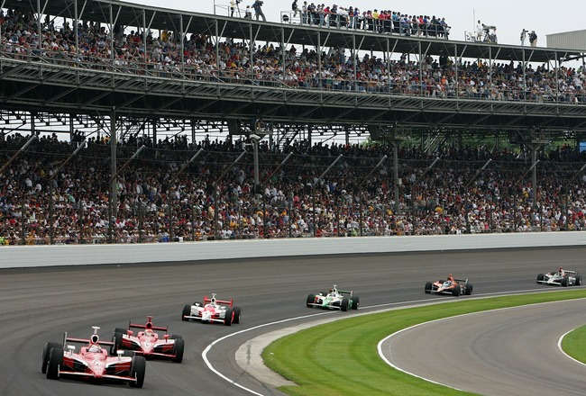 INDIANAPOLIS - MAY 27:  Scott Dixon, driver of the #9 Target Chip Ganassi Racing Dallara Honda, leads Dan Wheldon, driver of the #10 Chip Ganassi Racing Dallara Honda and Sam Hornish Jr., driver of the #6 Team Penske Dallara Honda, during the IRL IndyCar