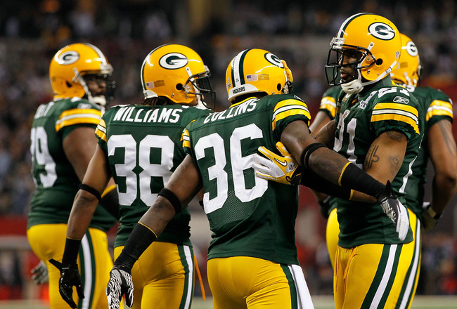 ARLINGTON, TX - FEBRUARY 06:  Charles Woodson (R) #21 of the Green Bay Packers congratulates Nick Collins #36 after COllins scored a touchdown on an interception return against the Pittsburgh Steelers during Super Bowl XLV at Cowboys Stadium on February 6