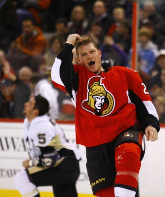OTTAWA, CANADA - MARCH 15:  Chris Neil #25 of the Ottawa Senators gestures to the crowd after a fight with Deryk Engelland #5 of the Pittsburgh Penguins during a game at Scotiabank Place on March 15, 2011 in Ottawa, Canada.  (Photo by Phillip MacCallum/Ge