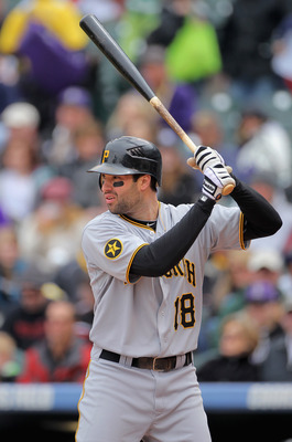DENVER, CO - MAY 01:  Second baseman Neil Walker #18 of the Pittsburgh Pirates takes an at bat against the Colorado Rockies at Coors Field on May 1, 2011 in Denver, Colorado. The Pirates defeated the Rockies 8-4.  (Photo by Doug Pensinger/Getty Images)