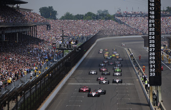 INDIANAPOLIS - MAY 30:  Helio Castroneves of Brazil, driver of the #3 Team Penske Dallara Honda, leads the field at the start of the IZOD IndyCar Series 94th running of the Indianapolis 500 at the Indianapolis Motor Speedway on May 30, 2010 in Indianapoli