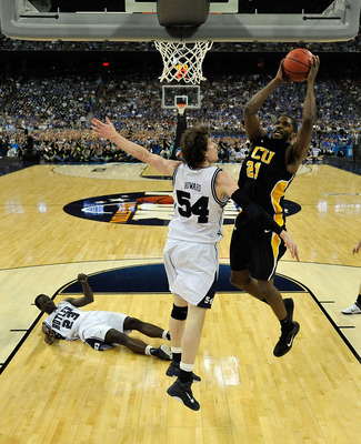 HOUSTON, TX - APRIL 02:  Jamie Skeen #21 of the Virginia Commonwealth Rams goes to the hoop against Matt Howard #54 of the Butler Bulldogs during the National Semifinal game of the 2011 NCAA Division I Men's Basketball Championship at Reliant Stadium on A
