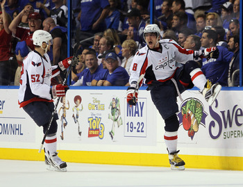 TAMPA, FL - MAY 03: Alex Ovechkin #8 of the Washington Capitals scores a power play goal at 17:27 of the second period against the Tampa Bay Lightning and is joined by Mike Green #52 in Game Three of the Eastern Conference Semifinals during the 2011 NHL S