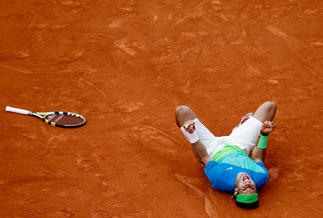 PARIS - JUNE 06:  Rafael Nadal of Spain celebrates winning championship point during the men's singles final match between Rafael Nadal of Spain and Robin Soderling of Sweden on day fifteen of the French Open at Roland Garros on June 6, 2010 in Paris, Fra