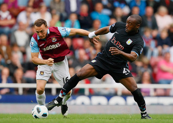LONDON, ENGLAND - APRIL 16:  Mark Noble of West Ham United and Nigel Reo-Coker of Aston Villa battle for the ball during the Barclays Premier League match between West Ham United and Aston Villa at the Boleyn Ground on April 16, 2011 in London, England.