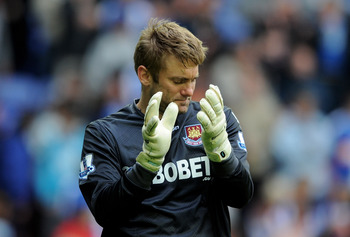 WIGAN, ENGLAND - MAY 15:  Robert Green of West Ham United acknowledges the fans at the end of the Barclays Premier League match between Wigan Athletic and West Ham United at the DW Stadium on May 15, 2011 in Wigan, England.  (Photo by Chris Brunskill/Gett