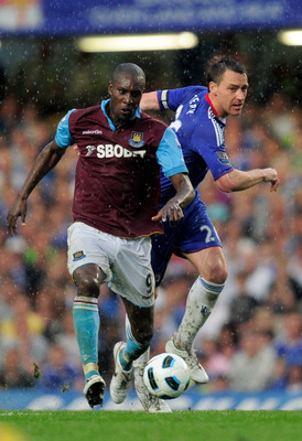 LONDON, ENGLAND - APRIL 23:  Carlton Cole of West Ham holds off the challenge from John Terry of Chelsea during the Barclays Premier League match between Chelsea and West Ham United at Stamford Bridge on April 23, 2011 in London, England.  (Photo by Jamie