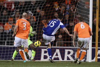 BLACKPOOL, ENGLAND - JANUARY 04:  Scott Dann of Birmingham City scores the winning goal during the Barclays Premier League match between Blackpool and Birmingham City at Bloomfield Road on January 4, 2011 in Blackpool, England.  (Photo by Alex Livesey/Get