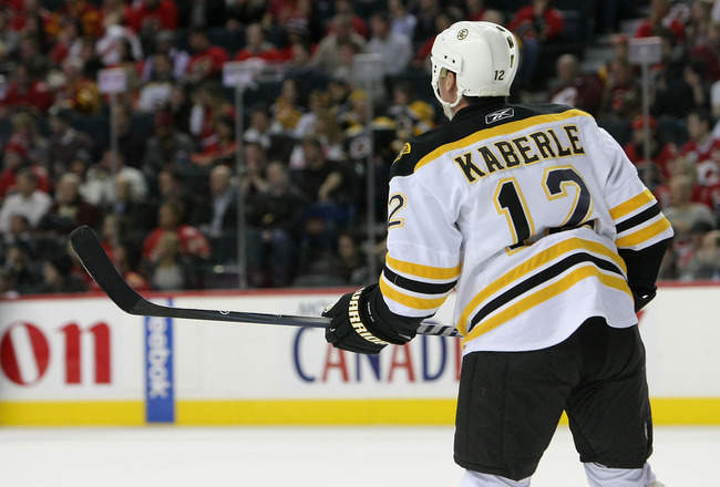 CALGARY,CANADA - FEBRUARY 22:  Tomas Kaberle #12 of the Boston Bruins skates against the Calgary Flames during their NHL game at Scotiabank Saddledome, February 22,2011 in Calgary, Alberta, Canada.(Photo By Dave Sandford/Getty Images)