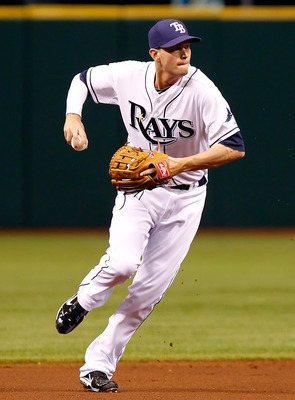 ST. PETERSBURG, FL - APRIL 15:  Infielder Reid Brignac #15 of the Tampa Bay Rays throws over to first for an out against the Minnesota Twins during the game at Tropicana Field on April 15, 2011 in St. Petersburg, Florida.  (Photo by J. Meric/Getty Images)