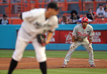 MIAMI GARDENS, FL - MAY 10:  Shane Victorino #8 of the Philadelphia Phillies leads off against Josh Johnson #55 of the Florida Marlins during a game at Sun Life Stadium on May 10, 2011 in Miami Gardens, Florida.  (Photo by Mike Ehrmann/Getty Images)