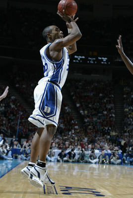 08 Mar 2002:  Jason Williams #22 of Duke shoots over the defense of North Carolina during the ACC Tournament game at the Charlotte Coliseum in Charlotte, North Carolina. Duke won 60-48. DIGITAL IMAGE Mandatory Credit: Craig Jones/Getty Images