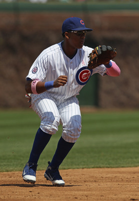 CHICAGO, IL - MAY 08: Starlin Castro #13 of the Chicago Cubs fields the ball against the Cincinnati Reds at Wrigley Field on May 8, 2011 in Chicago, Illinois. The Reds defeated the Cubs 2-0. (Photo by Jonathan Daniel/Getty Images)