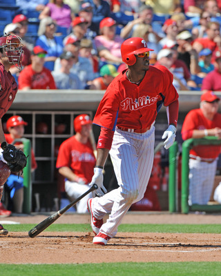 CLEARWATER, FL - FEBRUARY 24:  Outfielder Domonic Brown #9 of the Philadelphia Phillies singles in the first inning against the Florida State Seminoles February 24, 2011 at Bright House Field in Clearwater, Florida.  (Photo by Al Messerschmidt/Getty Image
