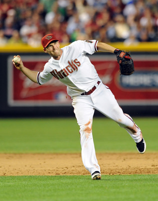 PHOENIX - MAY 20:  Stephen Drew #6 of the Arizona Diamondbacks makes a barehanded play against the Minnesota Twins at Chase Field on May 20, 2011 in Phoenix, Arizona.  (Photo by Norm Hall/Getty Images)