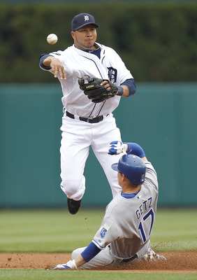 DETROIT, MI - APRIL 08:  Jhonny Peralta #27 of the Detroit Tigers turns a double play over Chris Getz #17 of the Kansas City Royals during Opening Day at Comerica Park on April 8, 2011 in Detroit, Michigan.  (Photo by Gregory Shamus/Getty Images)