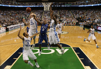 GREENSBORO, NC - MARCH 13:  Nolan Smith #2 of the Duke Blue Devils battles against Tyler Zeller #44, Kendall Marshall #5 and Harrison Barnes #40 of the North Carolina Tar Heels during the second half in the championship game of the 2011 ACC men's basketba