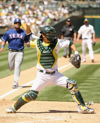 OAKLAND, CA - APRIL 30:  Kurt Suzuki #8 of the Oakland Athletics in action against the Texas Rangers at Oakland-Alameda County Coliseum on April 30, 2011 in Oakland, California.  (Photo by Ezra Shaw/Getty Images)