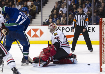 VANCOUVER, CANADA - FEBRUARY 4: Ryan Kesler #17 of the Vancouver Canucks watches the shot of teammate Mikael Samuelsson slide past goalie Marty Turco #30 of the Chicago Blackhawks during the second period in NHL action on February 04, 2011 at Rogers Arena