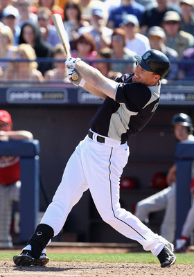 PEORIA, AZ - MARCH 04:  Justin Smoak #17 of the Seattle Mariners bats against the Cincinnati Reds during the spring training game at Peoria Stadium on March 4, 2011 in Peoria, Arizona.  (Photo by Christian Petersen/Getty Images)