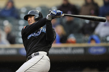 MINNEAPOLIS, MN - MAY 14: J.P. Arencibia #9 of the Toronto Blue Jays hits a two-run double against the Minnesota Twins during the eleventh inning of their game on May 14, 2011 at Target Field in Minneapolis, Minnesota. Blue Jays defeated the Twins 9-3 in
