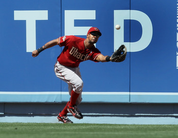 LOS ANGELES - MAY 15: Center fielder Chris Young #24 of the Arizona Diamondbacks makes a running catch on a fly bell hit by Jerry Sands of the Los Angeles Dodgers in the seventh inning on May 15, 2011 at Dodger Stadium in Los Angeles, California.   (Photo