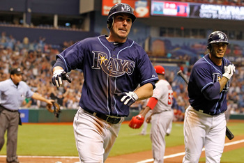 ST. PETERSBURG, FL - APRIL 30:  Outfielder Matt Joyce #20 of the Tampa Bay Rays scores the game winning run in the tenth inning against the Los Angeles Angels of Anaheim at Tropicana Field on April 30, 2011 in St. Petersburg, Florida.  (Photo by J. Meric/