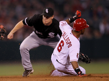 ANAHEIM, CA - MAY 10:   Alberto Callaspo #6 of the Los Angeles Angels of Anaheim slides into second as he takes the base on the throw after his RBI single in the third inning as second baseman Gordon Beckham #15 of the Chicago White Sox covers on May 10,