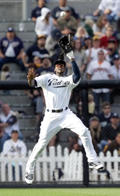 SAN DIEGO, CA - APRIL 5:  Center Fielder Cameron Maybin #24 of the San Diego Padres jumps to grab a fly ball for an out during the Padres 3-1 win over the San Francisco Giants at Petco Park on April 5, 2011 in San Diego, California. (Photo by Donald Miral