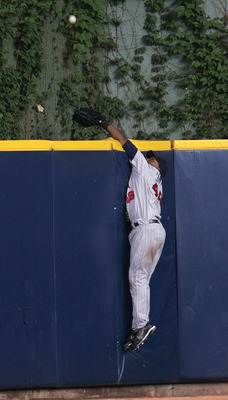 MILWAUKEE - MAY 20:  Torii Hunter #48 of the Minnesota Twins leaps in vain to catch the 200th career home run ball of Geoff Jenkins of the Milwaukee Brewers in the 5th inning on May 20, 2007 at Miller Park in Milwaukee, Wisconsin.  (Photo by Jonathan Dani