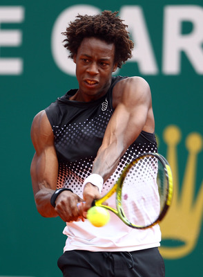 MONACO - APRIL 13:  Gael Monfils of France in action against Daniel Gimeno-Traver of Spain during Day Four of the ATP Masters Series Tennis at the Monte Carlo Country Club on April 13, 2011 in Monte Carlo, Monaco.  (Photo by Julian Finney/Getty Images)