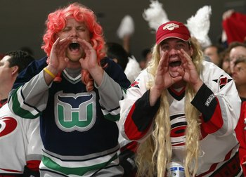 RALEIGH, NC - JUNE 14:  Fans of the Carolina Hurricanes cheer during game five of the 2006 NHL Stanley Cup Finals against the Edmonton Oilers on June 14, 2006 at the RBC Center in Raleigh, North Carolina.  (Photo by Dave Sandford/Getty Images)
