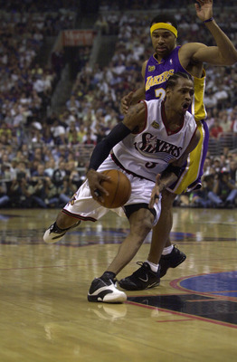 15 Jun 2001:  Allen Iverson #3 of the Philadelphia 76ers drives past Derek Fisher #2 of the Los Angeles Lakers in game five of the NBA Finals at the First Union Center in Philadelphia, Pennsylvania.  The Lakers won 108-86 to take the series 4-1 and the NB