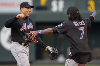 DENVER, CO - MAY 12:  Carlos Beltran #15 and Jose Reyes #7 of the New York Mets celebrate their 9-5 victory over the Colorado Rockies at Coors Field on May 12, 2011 in Denver, Colorado.  (Photo by Doug Pensinger/Getty Images)