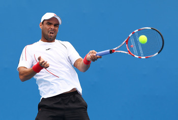 MELBOURNE, AUSTRALIA - JANUARY 18:  Alejandro Falla of Colombia plays a forehand in his first round match against Feliciano Lopez of Spain during day two of the 2011 Australian Open at Melbourne Park on January 18, 2011 in Melbourne, Australia.  (Photo by