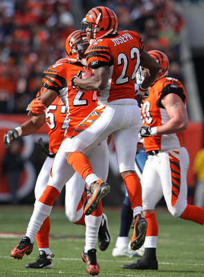 CINCINNATI - NOVEMBER 25:  Johnathan Joseph #22 of the Cincinnati Bengals celebrates with Deltha O'Neal #24 after Joseph intercepted a pass at Paul Brown Stadium November 25, 2007 in Cincinnati, Ohio.  (Photo by Andy Lyons/Getty Images)